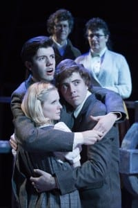 Front, Jaron Barney as Melchior, Dylan MacDonald as Moritz, and Jackie Jensen as Wendla. Rear, Bob Nelson as The Adult Men and Sarah Shippobotham as The Adult Women. Photo by Spencer Sandstrom.