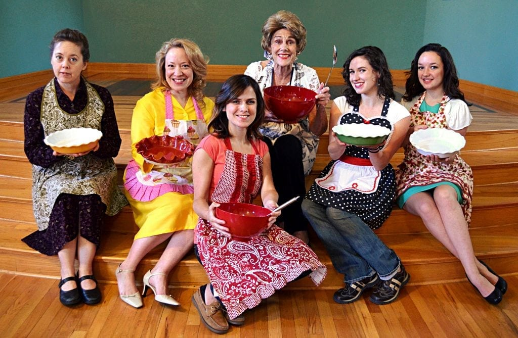 Anne Cullimore Decker as Emma and Jim Dale as Dimitri. The six Righteous Housewives of Utah County in their aprons, ready to cook up a meal. Left to right: Holly Fowers, April Fossen, Anne Cullimore Decker, Anne Louise Brings, Haley McCormick, and Nicki Nixon on the front row. Photo by Morgan Donavan, courtesy of AP Productions.