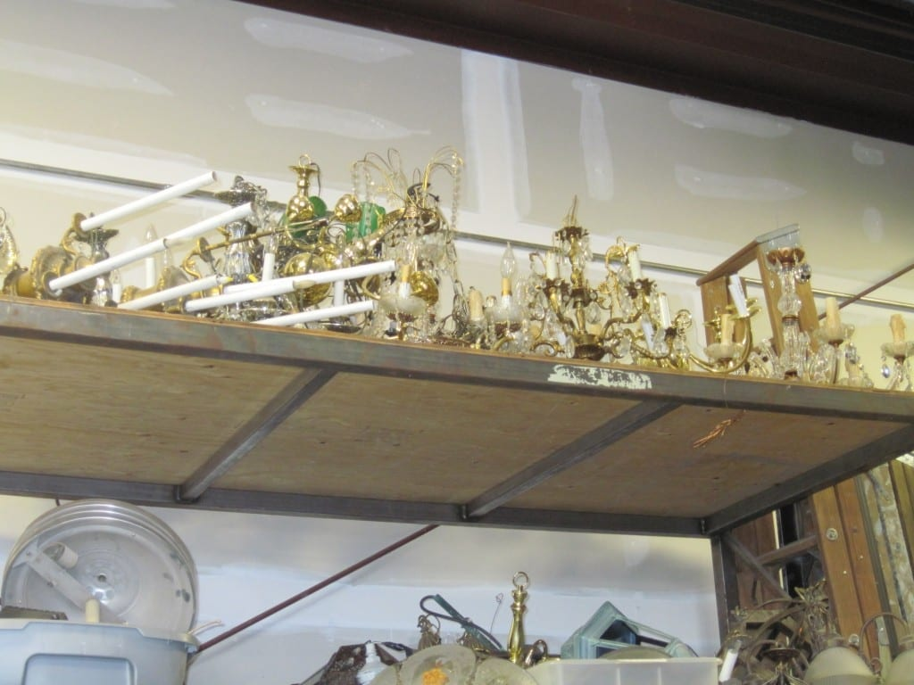 Dozens of candlesticks, candelabras, and chandeliers have their own shelf in the storage facility.