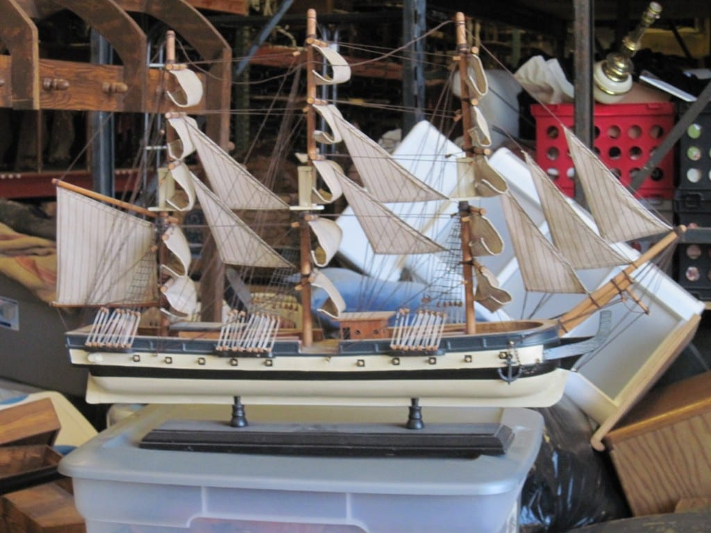 One of our favorite pieces is this model wooden ship that can be seen in the background of the photo above.