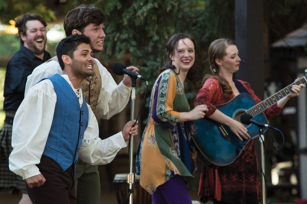 Chad Ryan Baker (left) as Musician, Steven Rada as Featured Performer, James N. Scully as Featured Performer, Molly Wetzel as Featured Performer, and Natasha Harris as Featured Performer in the Utah Shakespeare Festival's 2013 production of The Greenshow. (Photo by Karl Hugh. Copyright Utah Shakespeare Festival 2013.)