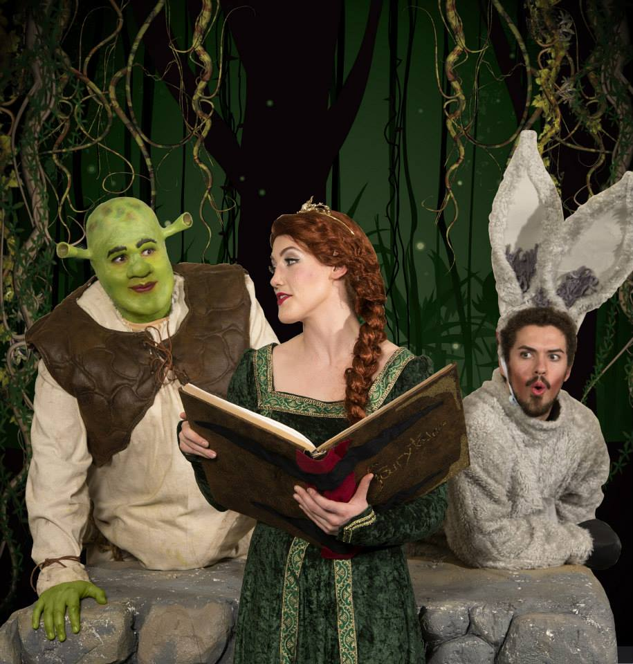 B. J. Oldroyd as Shrek, Madeline Weinberger as Princess Fiona, and Wes Tolman as Donkey. Photo by Mark A. Philbrick.
