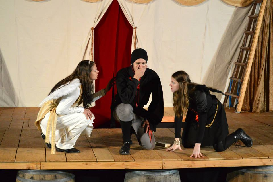Kaitlyn Dahl as the Good Angel, Eric D. Geels as Doctor Faustus, and Victoria Truax as the Bad Angel.