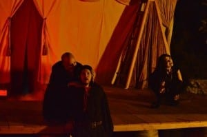 Amos Omer (crouched, left) as Lucifer, Eric D. Geels (standing, front) as Doctor Faustus, and Maddie Forsyth (crouched, right) as a devil.