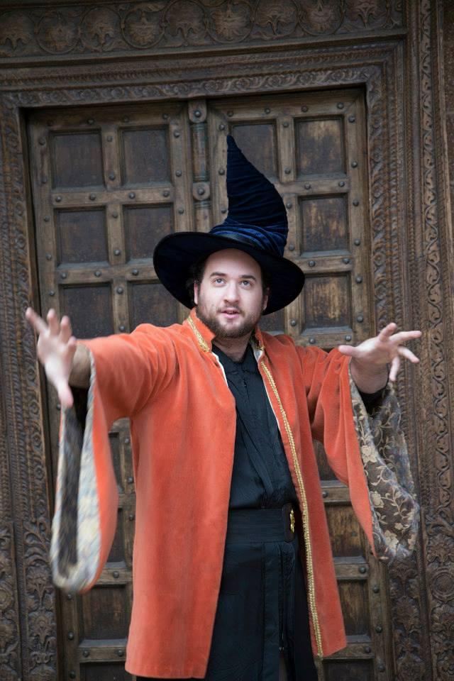 Justin Stockett as Merlin.