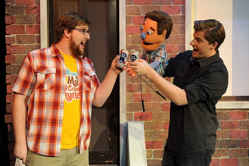 Taylor Smith as Brian, Princeton, and puppeteer Austin John Smith. Photo by Gary Oakeson.