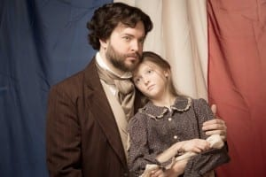 Kyle Olsen as Jean Valjean and Elise K. Anderson as Young Cosette.