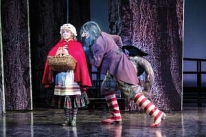 Deanna Ott (left) as Little Red Ridinghood and Peter Saide as Wolf in the Utah Shakespeare Festival's 2014 production of Into the Woods. (Photo by Karl Hugh. Copyright Utah Shakespeare Festival 2014.)