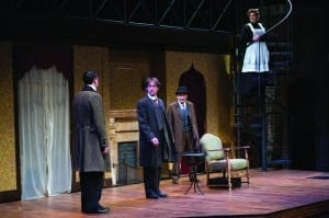 Drew Shirley (left) as James Larrabee, J. Todd Adams as Sherlock Holmes, David Pichette as Sid Prince, and Bree Murphy as Madge Larrabee in the Utah Shakespeare Festival's 2014 production of Sherlock Holmes: The Final Adventure. (Copyright Utah Shakespeare Festival, 2014. Photo by Karl Hugh.)