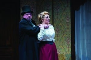 Roderick Peeples (left) as Professor Moriarty and Melinda Pfundstein as Irene Adler in the Utah Shakespeare Festival's 2014 production of Sherlock Holmes: The Final Adventure. (Copyright Utah Shakespeare Festival, 2014. Photo by Karl Hugh.)
