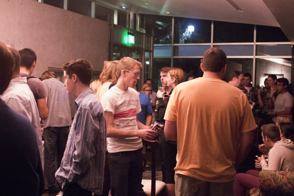 Audience members mingling after the opening night of Blood Wedding in the Noorda Theatre lobby.
