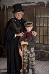 Scott VanDyke as Scrooge and Truman Harris as Tiny Tim. Photo by Ron Russell.