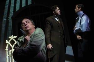 Chris Mixon (left) as Renfield, John G. Preston as Van Helsing, and John Maltese as Seward in the Utah Shakespeare Festival's 2015 production of Dracula. (Photo by Karl Hugh. Copyright Utah Shakespeare Festival 2015.)