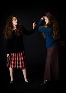 Natalia Noble as Carrie and Rachel Lynn Shull as Margaret in Utah Repertory Theatre Company's Carrie: The Musical. Photo by Jenny K Photography.