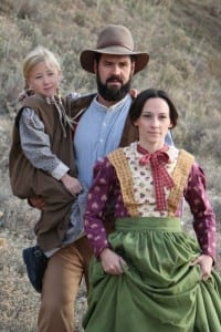 Left to right: Afton Higbee, Chris Higbee, and Shannon Eden as the Grant family.
