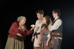 Left to right: Barta Heiner as Mother Courage, Dallin Halls as Eilif, Leah Hodson as Kattrin, and Jordan Nicholes as Swiss Cheese. Photo by Jaren Wilkey.